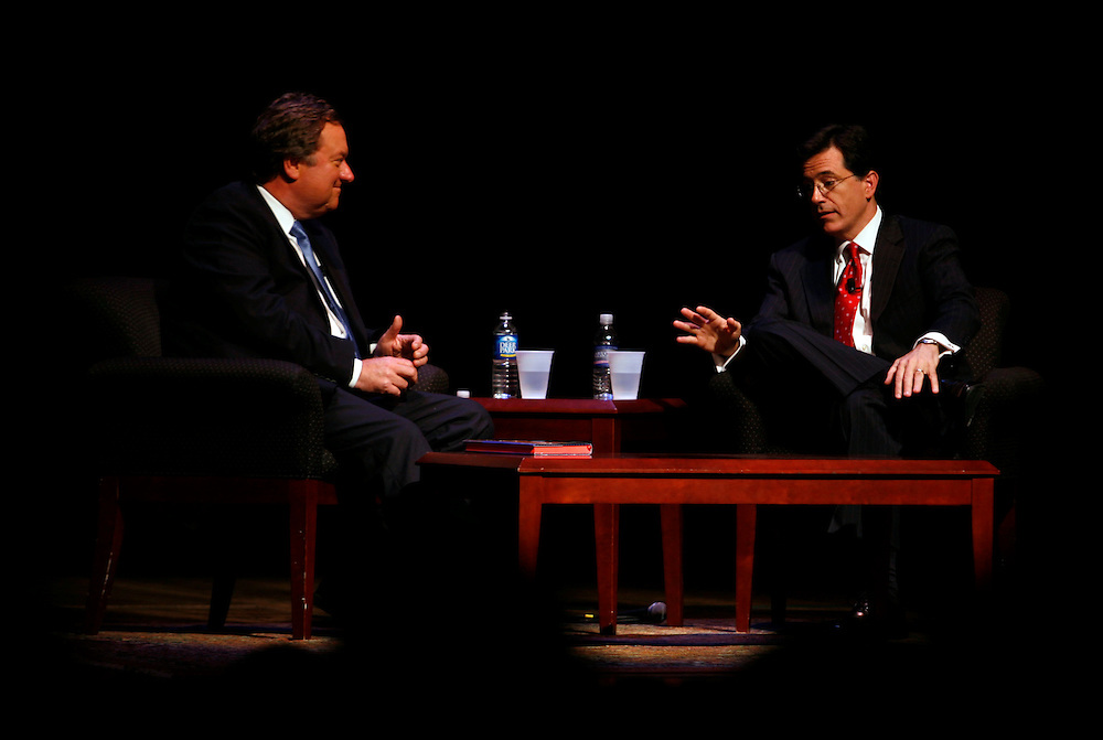 """Washington, Oct. 19, 2007 - Actor and comedian Stephen Colbert, right,  gestures while discussing his new book, """"I Am America (And So Can You)"""" with Tim Russert, left, during a book tour stop at George Washington University on Friday, Oct. 19, 2007 in Washington"""