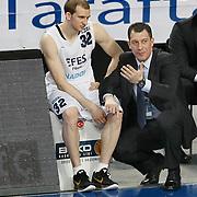 Efes Pilsen's coach Ufuk SARICA (R) and Sinan GULER (L) during their Turkish Basketball league match Efes Pilsen between Bornova Belediyespor at the Sinan Erdem Arena in Istanbul Turkey on Saturday 16 April 2011. Photo by TURKPIX