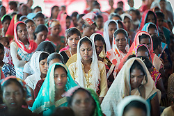 14 September 2018, Laxmipur, Nepal: Women congregants observe a moment of prayer, as more than 800 congregants, guests and dignitaries celebrate the 75th anniversary of the Nepal Evangelical Lutheran Church, an LWF member church.