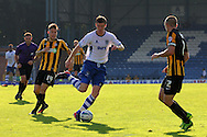 Bury's Andy Procter © breaks away past Southend's Kevan Hurst and John White. Skybet football league two match, Bury v Southend Utd at Gigg Lane in Bury, England on Sat 21st Sept 2013. pic by David Richards/Andrew Orchard sports photography