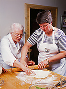 Madeleine Kamman showing Patty Park how to make a crust for a Blue Cheese Quiche, cooking seminar at Kirsten and Carl Dixon's Winterlake Lodge, Alaska.  (Model Released)