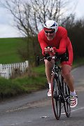 United Kingdom, Finchingfield, Mar 27, 2010:  Eric Angell, Redbridge CC, approaches the 4 miles to go marker during the 2010 edition of the 'Jim Perrin' Memorial Hardriders 25.5 mile Sporting TT promoted by Chelmer Cycling Club. Copyright 2010 Peter Horrell.