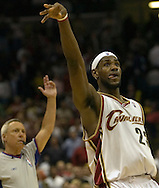 PHOTO BY DAVID RICHARD.LeBron James follows through on a 3-point shot late in the fourth quarter that sealed Cleveland's win over Boston last night at Quicken Loans arena.