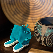 Tucson, AZ -- 09/28/2017<br /> <br /> San Agustin Trading Co.'s Jesse Aguilar has been handcrafting traditional moccasins since 1969. He makes moccasins for Arizona's Hopi and Navajo tribes.<br /> <br /> Mercado San Agustin, Tucson's only public marketplace with local shops, restaurants, and a weekly farmers market held on Thursdays. <br /> <br /> Photography by Jill Richards