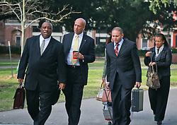 31 January 2014. New Orleans, Louisiana. <br /> Ray Nagin, former mayor of New Orleans walks to Federal court surrounded by his lawyers on the first full day of his corruption trial at the Federal Courthouse. Nagin's wife Seletha (right) appeared to support her husband. Nagin is charged with 21counts of corruption including  bribery, conspiracy, money laundering and wire fraud. <br /> Photo; Charlie Varley