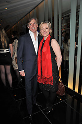 JO MALONE and her husband GARY WILLCOX at a party to celebrate the 15th birthday of Vogue.com held at W Hotel, Leicester Square, London W1 on 17th February 2011.
