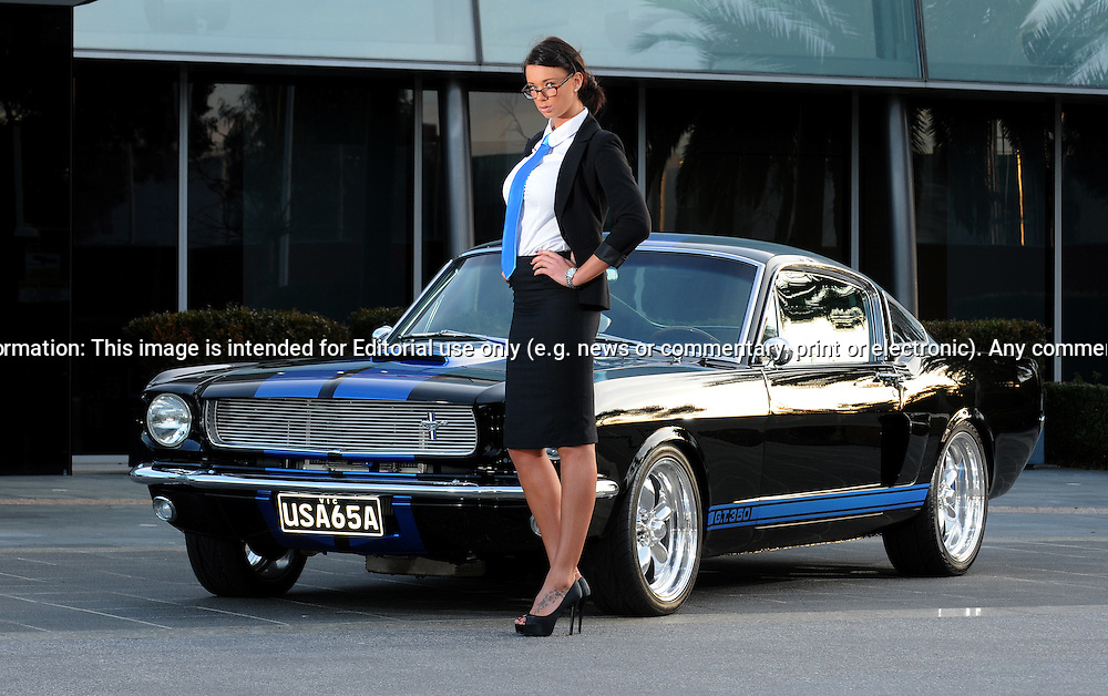 1965 Ford Mustang Fastback - Spicehecker 501 Base Black with Rally Blue.Port Melbourne, Victoria.31st of July 2011.(C) Joel Strickland Photographics.Use information: This image is intended for Editorial use only (e.g. news or commentary, print or electronic). Any commercial or promotional use requires additional clearance.