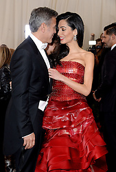"File photo : Amal Clooney and George Clooney attend the China: Through The Looking Glass Costume Institute Benefit Gala at Metropolitan Museum of Art on May 4, 2015 in New York City, NY, USA. Amal Clooney and her husband George are expecting twins, US media report. The babies are due in June, according to CBS's The Talk host Julie Chen. Another source close to the couple, quoted by People, said they were ""very happy"". The Clooneys' representatives have not yet commented. Photo by Lionel Hahn/ABACAPRESS.COM"