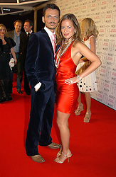 JADE JAGGER and MATTHEW WILLIAMSON at the Moet & Chandon Fashion Tribute 2005 to Matthew Williamson, held at Old Billingsgate, City of London on 16th February 2005.<br /><br />NON EXCLUSIVE - WORLD RIGHTS