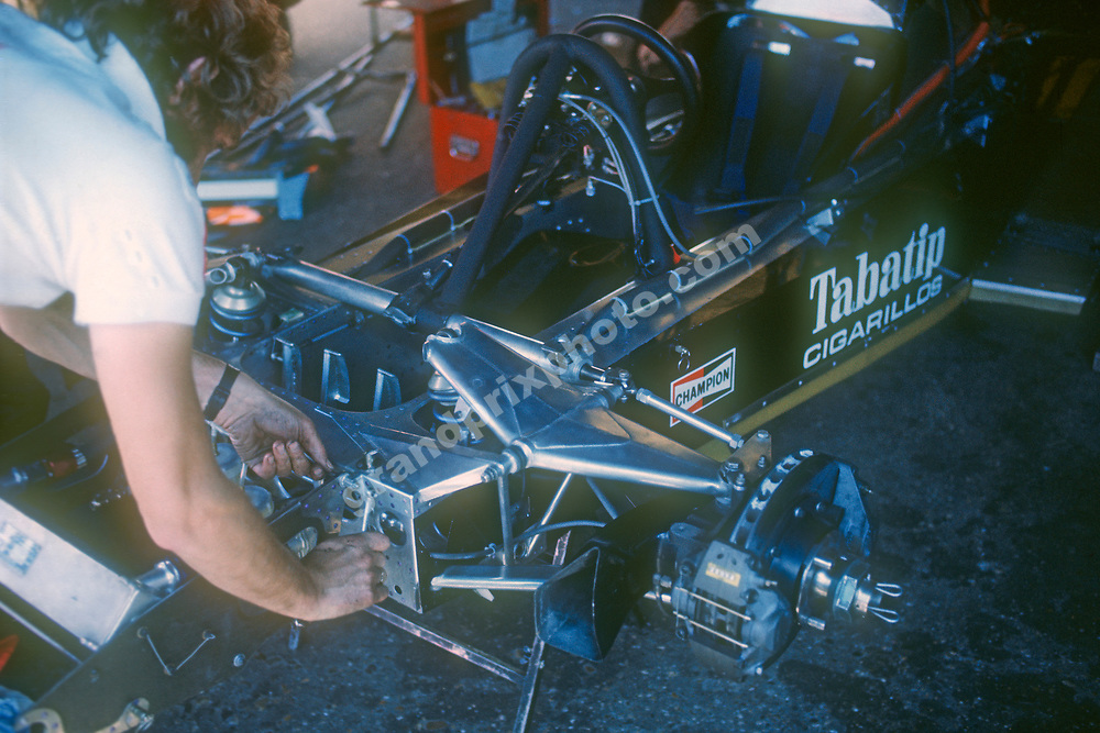 Mechanic working on Shadow-Ford (Jean-Pierre Jarier, Tom Pryce) Shadow-Ford monocoque, front brake ands skirts in the paddock before the 1976 Dutch Grand Prix in Zandvoort. Photo: Grand Prix Photo