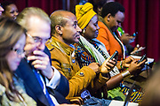The audience participate in a survey at the 2014 Stars Foundation Philanthropreneurship Forum, Regents Park, London.