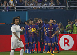 Barcelona midfielder Ivan Rakitic is congratulated by teammates after scoring the second goal during the first half against Real Madrid in International Champions Cup action on Saturday, July 29, 2017, at Hard Rock Stadium in Miami Gardens, FL, USA. Photo by David Santiago/El Nuevo Herald/TNS/ABACAPRESS.COM
