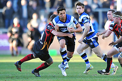 Gavin Henson (Bath) takes on the Dragons defence - Photo mandatory by-line: Patrick Khachfe/JMP - Tel: Mobile: 07966 386802 11/01/2014 - SPORT - RUGBY UNION -  Rodney Parade, Newport - Newport Gwent Dragons v Bath - Amlin Challenge Cup.