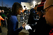 Nathan Ake (5) of AFC Bournemouth signing his autograph for fans as he arrives at the Vitality Stadium before the Premier League match between Bournemouth and Chelsea at the Vitality Stadium, Bournemouth, England on 30 January 2019.