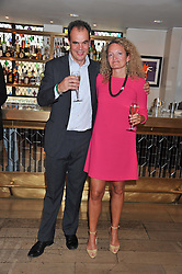 JAKE ARNOTT and STEPHANIE THEOBALD at a party to celebrate the publication on The House of Rumour by Jake Arnott held at The Ivy Club, West Street, London on 9th July 2012.