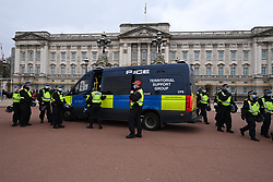 © Licensed to London News Pictures. 20/03/2021. London, UK. Riot police officers guard outside Buckingham Palace as anti-vaccination and anti-lockdown protesters take part in an organised demonstration in central London. The event took place to commemorate the first anniversary when the UK the first lockdown on 23rd March 2020 due to the rise in Covid-19 cases. Photo credit: Ray Tang/LNP