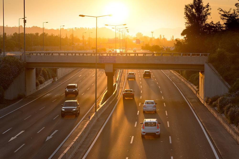 Costanera Norte highway in Vitacura district of Santiago de Chile at sunset.