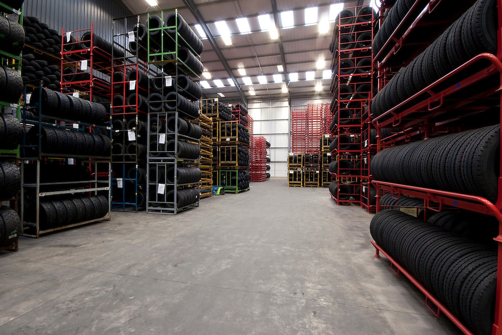Racked tyre storage area, of tyres stored on shelves in a warhouse