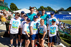 LIVERPOOL, ENGLAND - Sunday, June 24, 2018: Liverpool doubles duo brothers Neal and Ken Skupski  pose for a photograph with tournament ball boys and ball girls during day four of the Williams BMW Liverpool International Tennis Tournament 2018 at Aigburth Cricket Club. (Pic by Paul Greenwood/Propaganda)