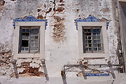 A detail of broken windows, crumbling plaster and brickwork, of a derelict, abandoned house that features traditional Portuguese tiles, on 12th July 2016, at Cascais, near Lisbon, Portugal. Across the country, and even at important tourist landmarks, buildings sit vacant and often collapsing. Sometimes it is because a previous generation have passed away to leave properties in the hands of arguing families. Beautiful buildings are therefore left to collapse in town centres. (Photo by Richard Baker / In Pictures via Getty Images)