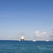 North America, Caribbean, Cayman Islands, Cayman, Grand Cayman, Georgetown,<br /> Massive cruise ships lining up in the harbor, Georgetown, Grand Cayman.