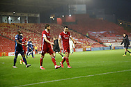 Aberdeen defender Ashton Taylor (14) and Aberdeen defender Andrew Considine (4) leave the pitch during the Scottish Premiership match between Aberdeen and Hamilton Academical FC at Pittodrie Stadium, Aberdeen, Scotland on 20 October 2020.