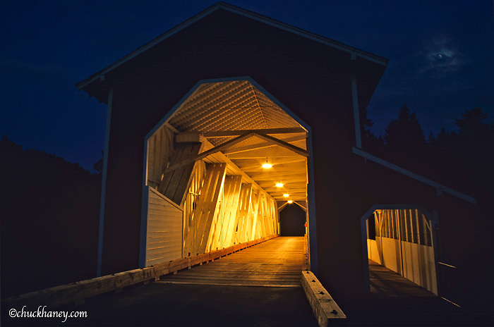 Office Covered Bridge lit up Oregon's longest at 180ft unique with a walkway in Westfir Oregon