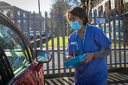 A patient about to receive their first dose of the COVID-19 AstraZeneca Oxford vaccine in their arm while attending the drive through vaccination centre in the car park of Folkestone council offices on Saturday the 27th of February 2021, Folkestone, Kent, United Kingdom.