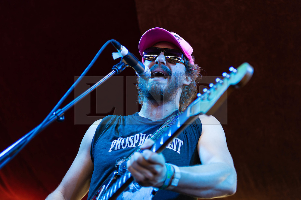 © Licensed to London News Pictures. 12/07/2014. London, UK.   Phosphorescent performing live at Hyde Park as part of the British Summer Time series of outdoor concerts. In this picture - Matthew Houck.  Phosphorescent is the singer-songwriter, multi-instrumentalist and producer  Matthew Houck.   Photo credit : Richard Isaac/LNP