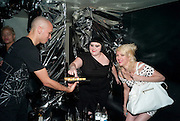 BETH DITTO WITH MINI MACARONS; TARA PERKINS, Mark Jacobs' Bang' fragrance preview. Harvey Nicholls. London. 22 July 2010. -DO NOT ARCHIVE-© Copyright Photograph by Dafydd Jones. 248 Clapham Rd. London SW9 0PZ. Tel 0207 820 0771. www.dafjones.com.