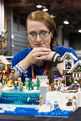 The SEC in Glasgow hosts Brick Live, the largest LEGO exhibition in the UK. Featuring models made up of over 6 million bricks, LEGO enthusiasts can build their own creations as well as admiring the models created by some of the leading designers including Scotland's Nick Clayton and Rocco Buttliere from Chicago.<br /> <br /> Pictured:  Alison Clayton looking onto an Ice Skating scene made from LEGO