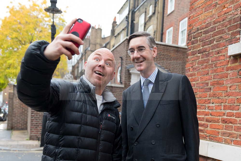 © Licensed to London News Pictures. 16/11/2018. London, UK.  Conservative MP, Jacob Rees-Mogg is stopped in the street by a passer by asking for a selfie photograph as he leaves his central London home this morning.  Photo credit: Vickie Flores/LNP