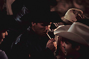 A cowboy lights a cigarette before entering the arena on a bull. Barretos Rodeo Championships, Brazil, August 2001.