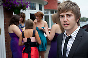Grace Meehan, 17, and friends from Whitley Bay High School, prepare to celebrate their leaving prom at the Life conference centre, Newcastle. In recent years American style prom nights to celebrate graduation from high School have been gaining popularity in the UK. These pictures are part of a set commissioned for the Times magazine that  look at this teenage rite of passage across three schools in the UK.