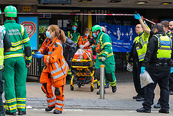 © Licensed to London News Pictures. 08/10/2020. London, UK. Paramedics take a person who was under the train at Wood Green underground station in north London. Photo credit: Dinendra Haria/LNP