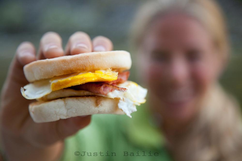River guide showing off her breakfast sandwich.