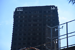 June 15, 2017 - London, England, United Kingdom - View of the aftermath of the fire at Grenfell Tower, London on June 15, 2017. Prime Minister, Theresa May ordered full public inquiry into the fire which left at least 17 dead. After the fire, only the skeleton of the 24-storey Grenfell Tower block remained. (Credit Image: © Alberto Pezzali/NurPhoto via ZUMA Press)