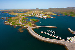 Aerial view from drone of port and village at Lochboisdale on island of South Uist in the Outer Hebrides, Scotland, UK