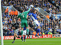 Photo: Tony Oudot/Richard Lane Photography. Leicester City v Derby County. Coca Cola Championship. 17/10/2009<br /> Stephen Bywater of Derby clears from Steve Howard of Leicester