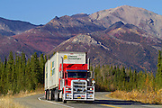 Alaska. Scenic autumn view of a Lynden Atransport truck traveling south through Broad Pass on the Parks Hwy, south of Cantwell.