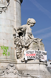 Anti-Le Pen graffitis are seen on the Statue of the Republic on the place de la Republique in Paris, France, on April 24, 2017, one day after moderate candidate Emmanuel Macron won the first round of France's presidential election and looked set to triumph in the run-off against far-right candidate Marine Le Pen next month. Photo by Alain Apaydin/ABACAPRESS.COM