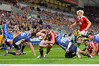 25 June 2013; Sean O'Brien, British & Irish Lions, goes over for his side's third try despite the tackle of Luke Jones, Melbourne Rebels. British & Irish Lions Tour 2013, Melbourne Rebels v British & Irish Lions. AAMI Park, Olympic Boulevard, Melbourne, Australia. Picture credit: Stephen McCarthy / SPORTSFILE