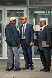 09 July 2014. New Orleans, Louisiana. <br /> Ray Nagin, former mayor of New Orleans leaves Federal Court in New Orleans following his sentencing hearing. He is greeted by friend Jerome Smith (l) and attorney Robert Jenkins art).  Nagin was sentenced to serve 10 years in prison for bribery and money laundering. <br /> Photo; Charlie Varley/varleypix.com