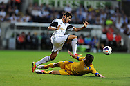 Swansea city's Alejandro Pozuelo makes a break. UEFA Europa league, play off round, 1st leg match, Swansea city v FC Petrolul Ploiesti at the Liberty stadium in Swansea on Thursday 22nd August 2013. pic by Andrew Orchard , Andrew Orchard sports photography,