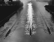The reflection of a just-awakened sun shivered in the wake of University of Washington shells slipping through the Lake Washington Ship Canal in a practice. (Josef Scaylea / The Seattle Times, 1967)