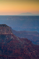Morning light over red rock cliffs along the North Rim at Point Sublime, Grand Canyon National Park, Arizona
