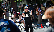 Security volunteer Maia Pickering of Seattle, Washington, frantically directs pedestrian traffic during the bike portion of Sunday's Ford Ironman competition at the intersection of Fourth Street and Lakeside Avenue..