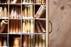 Multi Colored reels of sewing threads in drawer, Bavaria, Germany