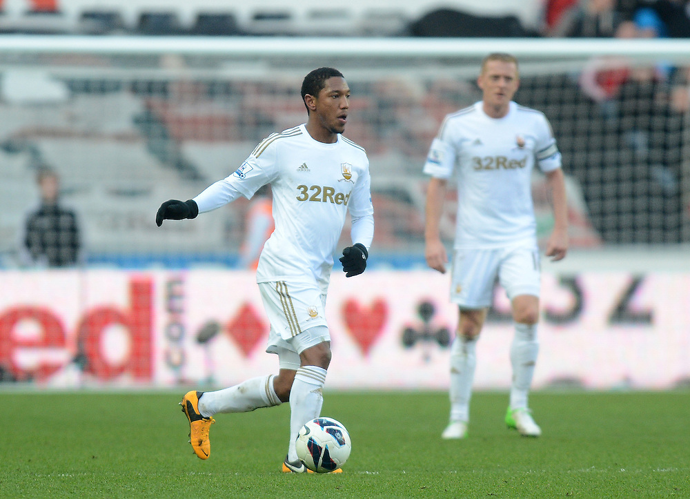 Swansea City's Jonathan de Guzman in action during todays match  ..Football - Barclays Premiership - Swansea City v Newcastle United  - Saturday 02nd March 2013 - Liberty Stadium - Swansea..© CameraSport - 43 Linden Ave. Countesthorpe. Leicester. England. LE8 5PG - Tel: +44 (0) 116 277 4147 - admin@camerasport.com - www.camerasport.com