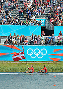 Eton Dorney, Windsor, Great Britain,..2012 London Olympic Regatta, Dorney Lake. Eton Rowing Centre, Berkshire.  Dorney Lake.  ..Men's Lightweight Doubles Sculls, after the medal ceremony, passing the crowd, gold Medalist. DEN LM2X, Rasmus QUIST and Mads RASMUSSEN...13:06:51  Saturday  04/08/2012   [Mandatory Credit: Peter Spurrier/Intersport Images]